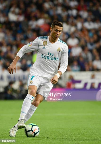 Real Madrid's Portuguese forward Cristiano Ronaldo controls the ball during the Spanish league football match Real Madrid CF vs SD Eibar at the...