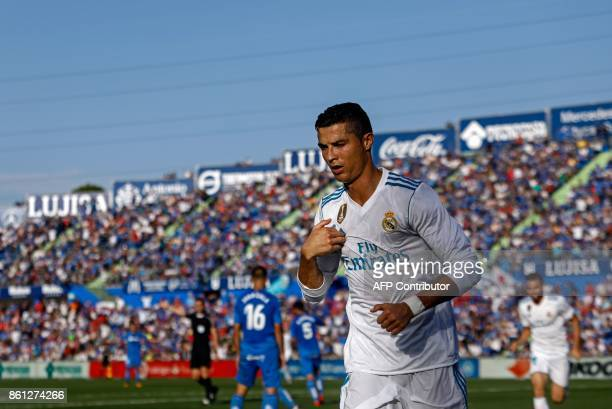 Real Madrid's Portuguese forward Cristiano Ronaldo crosses himself to celebrate his team's second goal during the Spanish league football match...