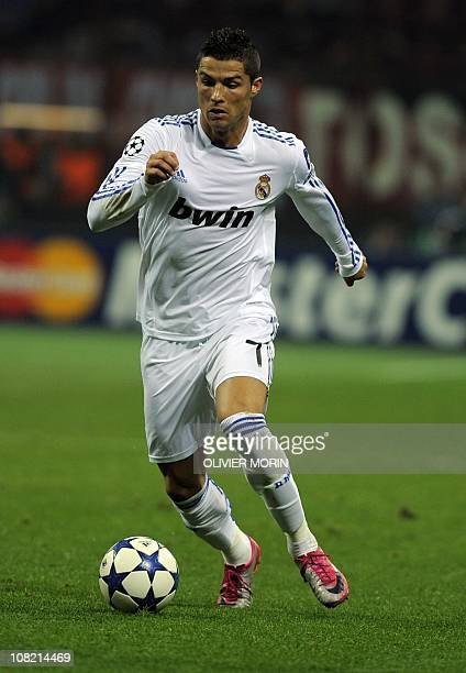 Real Madrid's Portuguese forward Cristiano Ronaldo escapes with the ball against AC Milan during their Champions League Group G football match on...