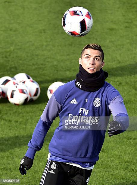Real Madrid's Portuguese forward Cristiano Ronaldo eyes a ball during a training session at Valdebebas training ground in Madrid on January 3 on the...