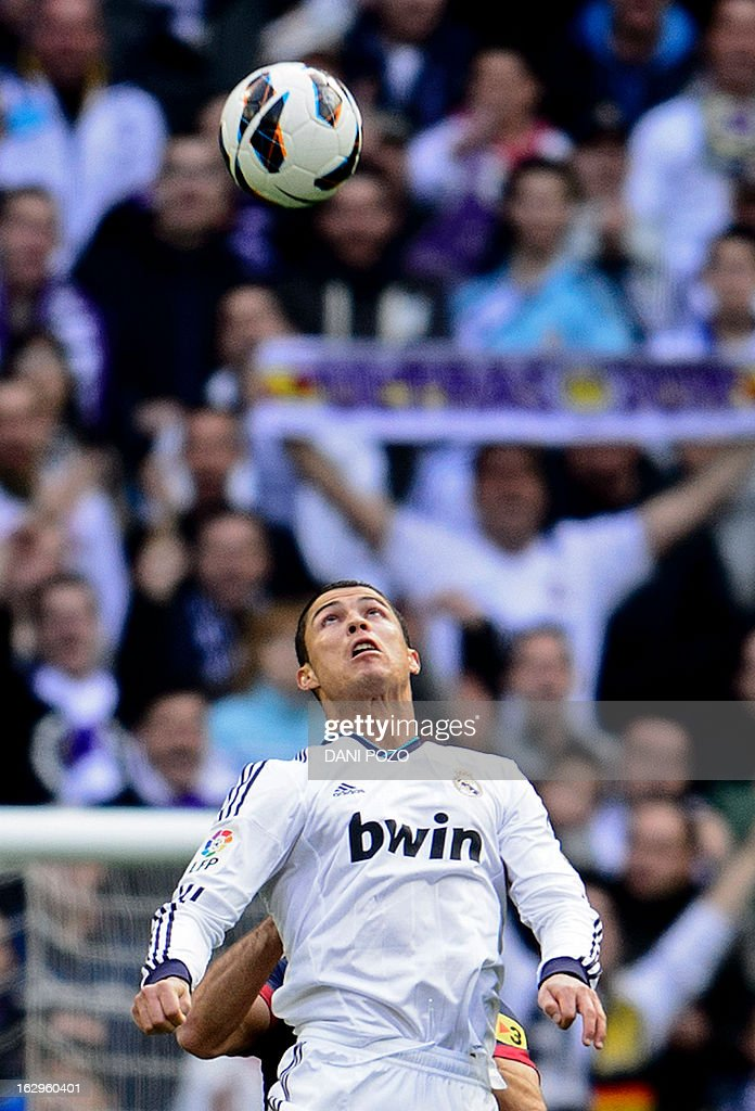 Real Madrid's Portuguese forward Cristiano Ronaldo eyes the ball during the 'El clasico' Spanish League football match Real Madrid vs Barcelona at the Santiago Bernabeu stadium in Madrid on March 2, 2013. Real Madrid won 2-1.