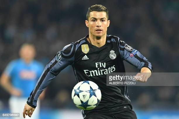 Real Madrid's Portuguese forward Cristiano Ronaldo eyes the ball during the UEFA Champions League football match SSC Napoli vs Real Madrid on March 7...