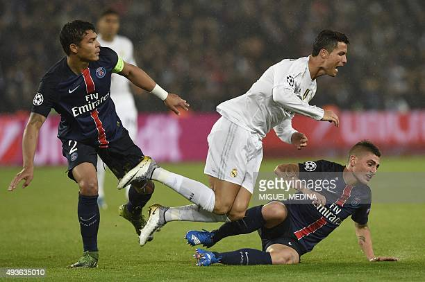 Real Madrid's Portuguese forward Cristiano Ronaldo fights for the ball with Paris SaintGermain's Brazilian defender Thiago Silva and Paris...