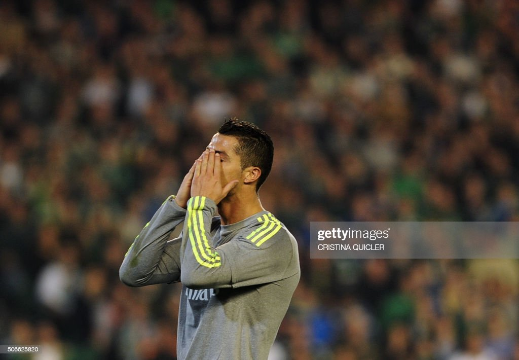 TOPSHOT Real Madrid's Portuguese forward Cristiano Ronaldo gestures after missing a goal during the Spanish league football match Real Betis Balompie...