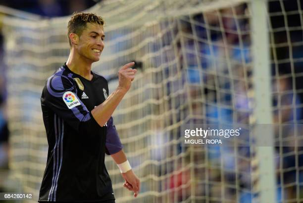 Real Madrid's Portuguese forward Cristiano Ronaldo gestures after missing a goal opportunity during the Spanish league football match RC Celta de...