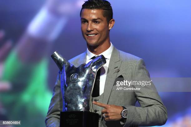 TOPSHOT Real Madrid's Portuguese forward Cristiano Ronaldo gestures as he poses with the trophy after he was awarded the title of 'Best Men's Player...