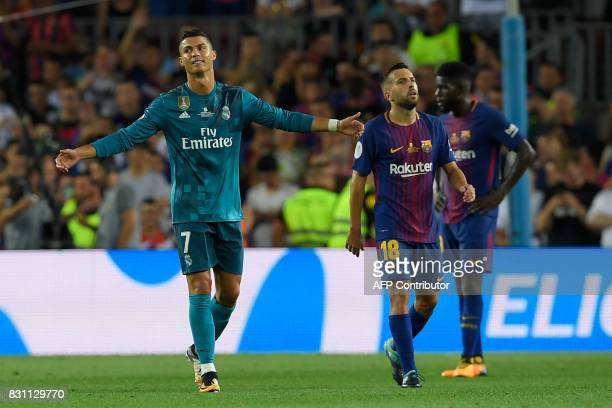 Real Madrid's Portuguese forward Cristiano Ronaldo gestures as he leaves the field after receiving his second yellow card during the Spanish Supercup...