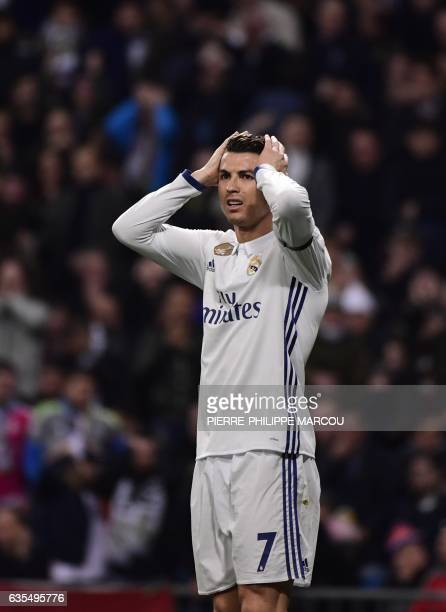 Real Madrid's Portuguese forward Cristiano Ronaldo gestures during the UEFA Champions League round of 16 first leg football match Real Madrid CF vs...