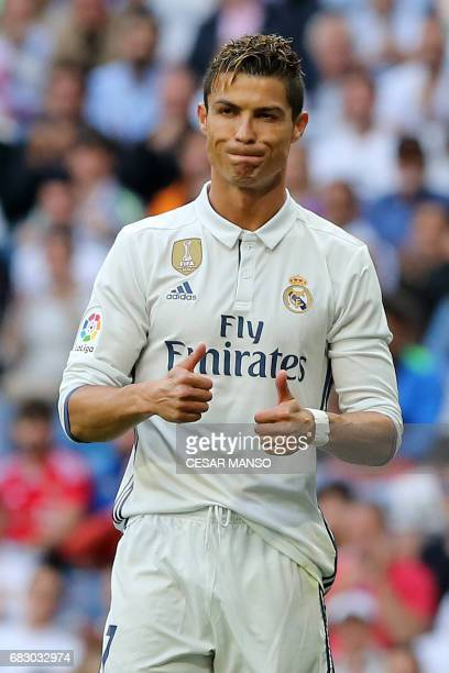Real Madrid's Portuguese forward Cristiano Ronaldo gestures during the Spanish league football match Real Madrid CF vs Sevilla FC at the Santiago...