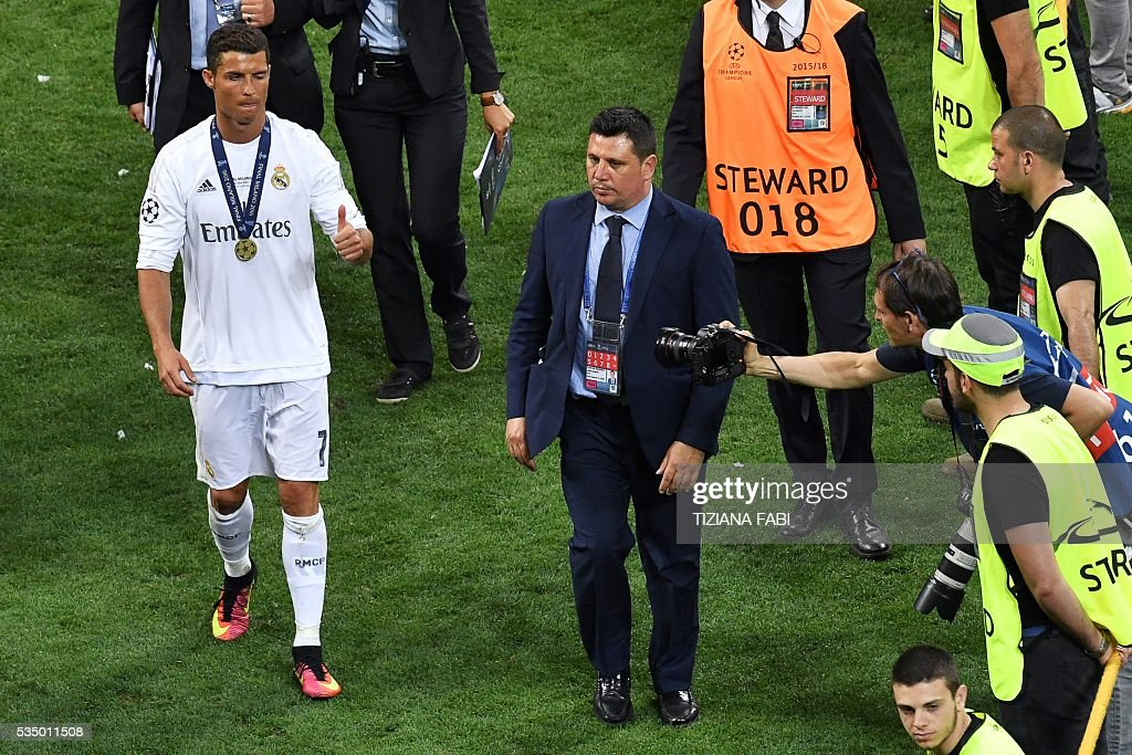Real Madrid's Portuguese forward Cristiano Ronaldo gives the tumbs-up to the press after winning the UEFA Champions League final football match between Real Madrid and Atletico Madrid at San Siro Stadium in Milan, on May 28, 2016. Real Madrid beat city rivals Atletico for the second time in three years to win the Champions League for the 11th time. / AFP / TIZIANA