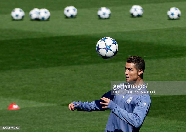 Real Madrid's Portuguese forward Cristiano Ronaldo heads a ball during a training session at Valdebebas Sport City in Madrid on May 1 2017 on the eve...