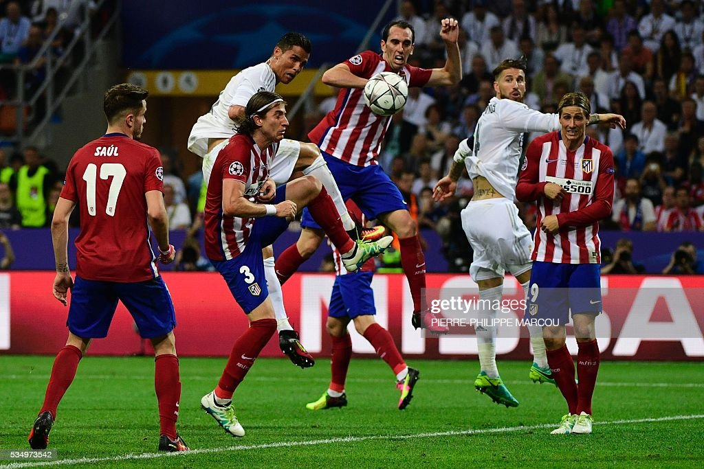 Real Madrid's Portuguese forward Cristiano Ronaldo heads the ball but failed to score during the UEFA Champions League final football match between Real Madrid and Atletico Madrid at San Siro Stadium in Milan, on May 28, 2016. / AFP / PIERRE