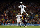 Real Madrid's Portuguese forward Cristiano Ronaldo heads the ball during the la Liga match between FC Barcelona and Real Madrid at the Camp Nou...