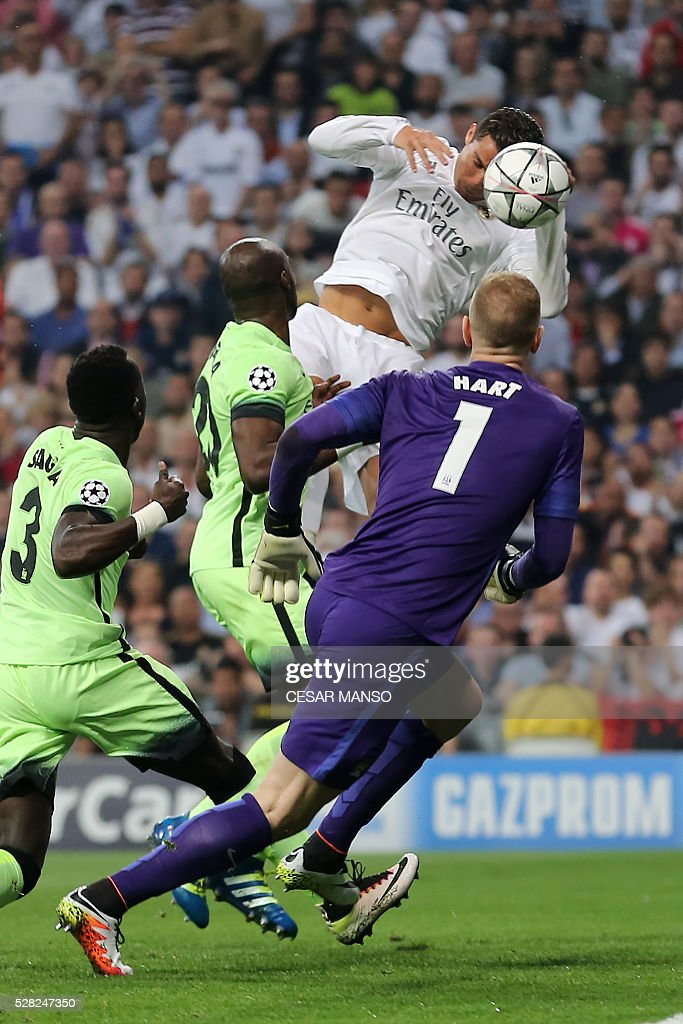 Real Madrid's Portuguese forward Cristiano Ronaldo (top) heads the ball during the UEFA Champions League semi-final second leg football match Real Madrid CF vs Manchester City FC at the Santiago Bernabeu stadium in Madrid, on May 4, 2016. / AFP / CESAR