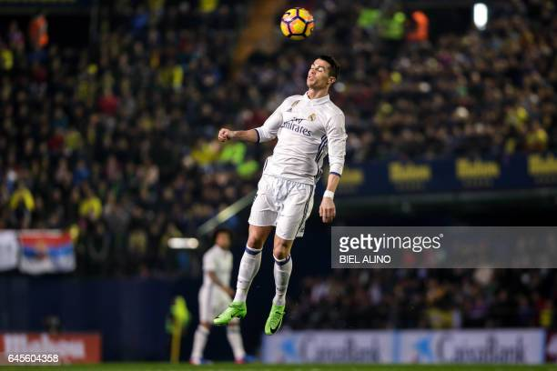 TOPSHOT Real Madrid's Portuguese forward Cristiano Ronaldo heads the ball during the Spanish League football match Villarreal CF vs Real Madrid at El...