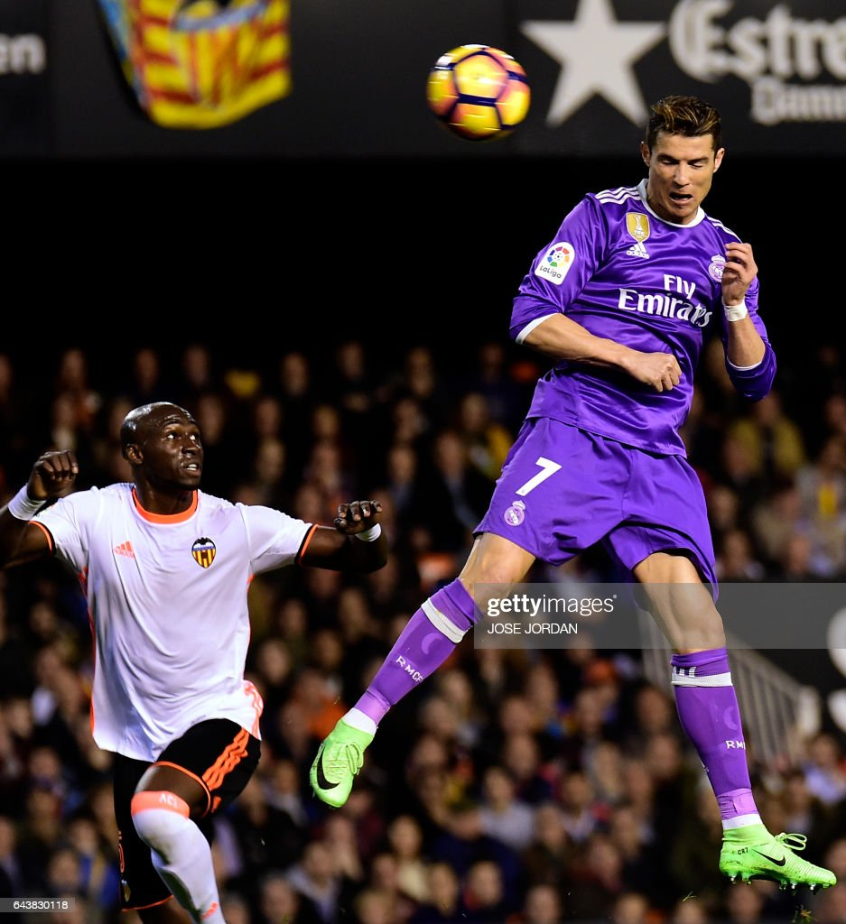 Real Madrid's Portuguese forward Cristiano Ronaldo heads the ball to score a goal during the Spanish league football match Valencia CF vs Real Madrid CF at the Mestalla stadium in Valencia on February 22, 2017. / AFP / JOSE