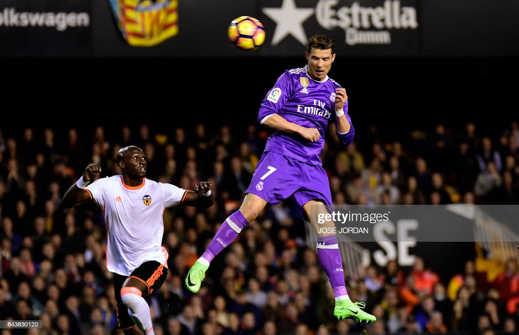 Real Madrid's Portuguese forward Cristiano Ronaldo heads the ball to score a goal during the Spanish league football match Valencia CF vs Real Madrid CF at the Mestalla stadium in Valencia on February 22, 2017. /