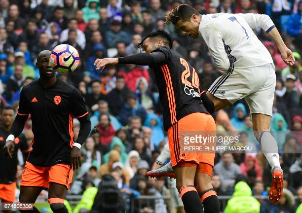Real Madrid's Portuguese forward Cristiano Ronaldo heads the ball to score a goal during the Spanish league football match Real Madrid CF vs Valencia...