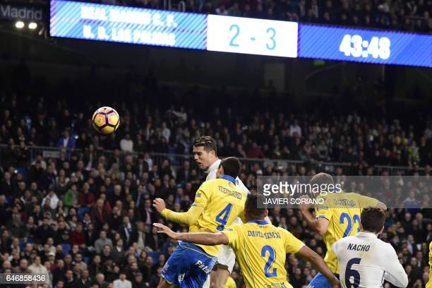 TOPSHOT Real Madrid's Portuguese forward Cristiano Ronaldo heads to score during the Spanish league football match Real Madrid CF vs UD Las Palmas at...