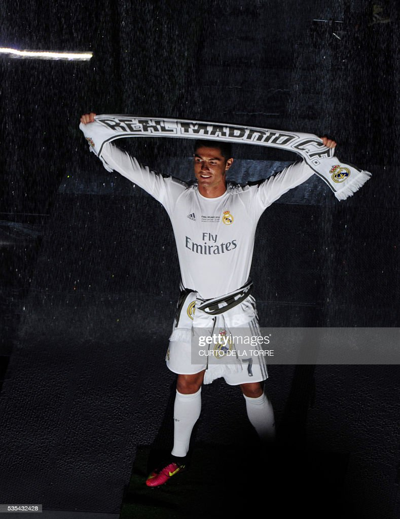 Real Madrid's Portuguese forward Cristiano Ronaldo holds a scarf during celebrations for their 11th UEFA Champions Cup at the Santiago Bernabeu stadium in Madrid on May 29, 2016, a day after winning the UEFA Champions League final foobtall match between Real Madrid CF, Club Atletico de Madrid held in Milan, Italy on May 28, 2016. / AFP / CURTO