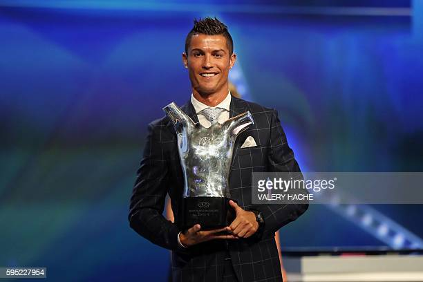 Real Madrid's Portuguese forward Cristiano Ronaldo holds his trophy of Best Men's player in Europe at the end of the UEFA Champions League Group...