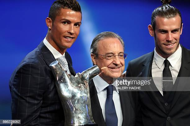 Real Madrid's Portuguese forward Cristiano Ronaldo holds his trophy of Best Men's player in Europe as he poses with Real Madrid President Florentino...