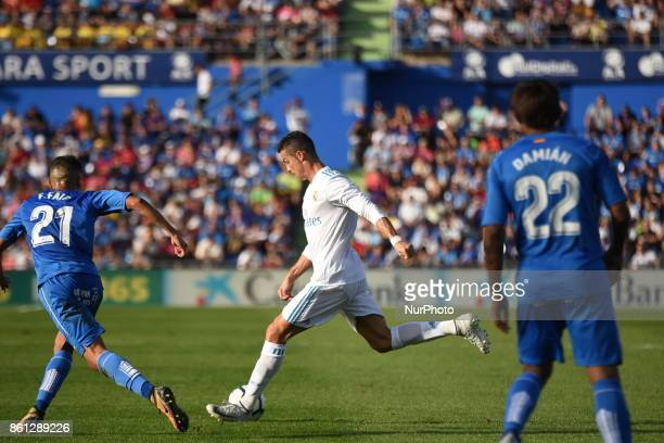 Real Madrid's Portuguese forward Cristiano Ronaldo in action during the Spanish league football match Getafe CF vs Real Madrid CF at the Col Alfonso...