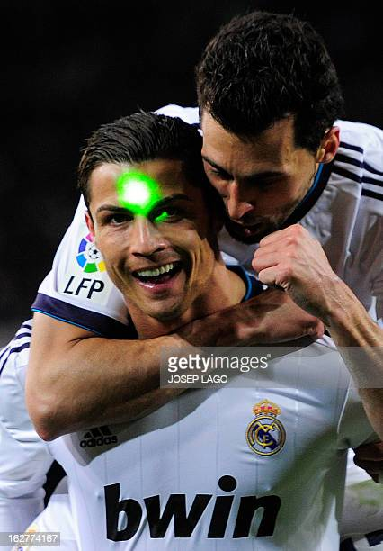 Real Madrid's Portuguese forward Cristiano Ronaldo is lit with a green laser on his face during the Spanish Cup semifinal secondleg football match FC...