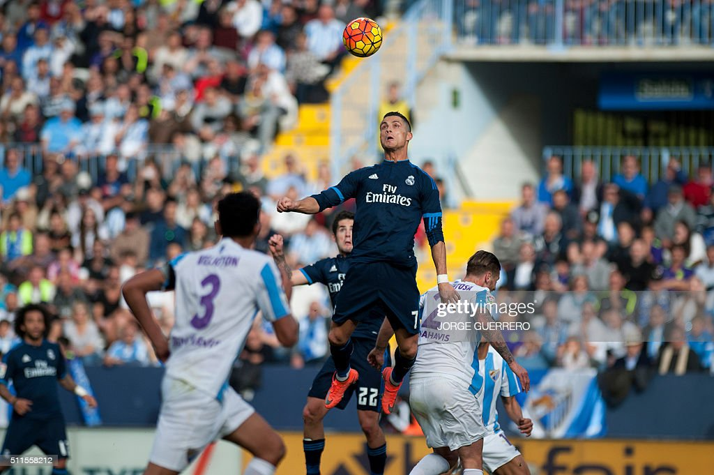 TOPSHOT Real Madrid's Portuguese forward Cristiano Ronaldo jumps for the ball during the Spanish league football match Malaga CF vs Real Madrid CF at...