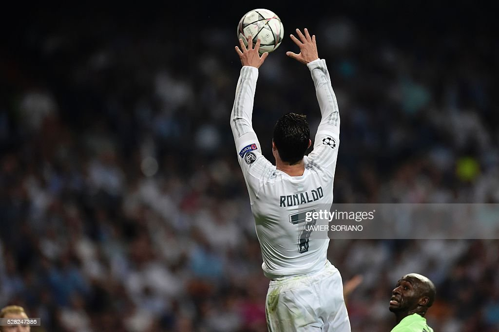 Real Madrid's Portuguese forward Cristiano Ronaldo jumps to catch the ball during the UEFA Champions League semi-final second leg football match Real Madrid CF vs Manchester City FC at the Santiago Bernabeu stadium in Madrid, on May 4, 2016. / AFP / JAVIER