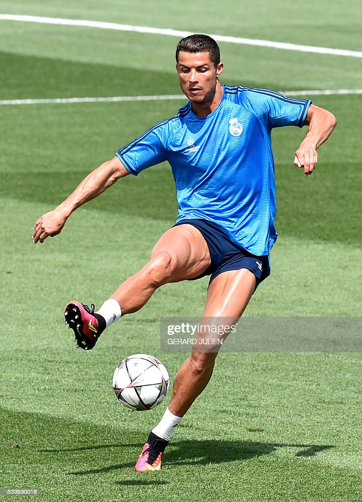 Real Madrid's Portuguese forward Cristiano Ronaldo kicks a ball during a training session on the club's Open Media Day at Real Madrid sport city in Madrid on May 24, 2016. / AFP / GERARD