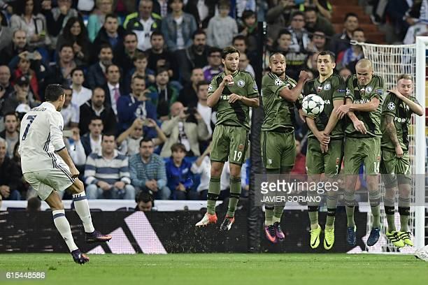TOPSHOT Real Madrid's Portuguese forward Cristiano Ronaldo kicks from a foul during the UEFA Champions League football match Real Madrid CF vs Legia...