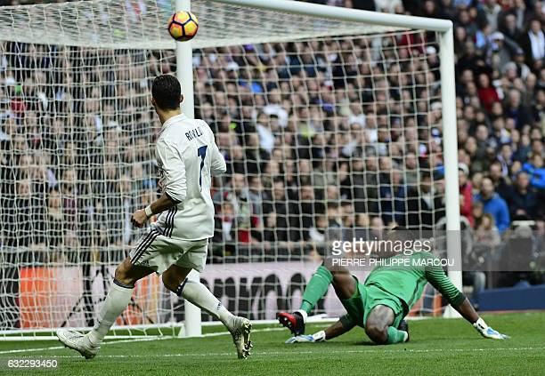 Real Madrid's Portuguese forward Cristiano Ronaldo kicks the ball towards Malaga's Cameroonian goalkeeper Idriss Kameni during the Spanish league...