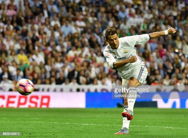 Real Madrid's Portuguese forward Cristiano Ronaldo kicks the ball during the Spanish league football match Real Madrid CF vs Sevilla FC at the...