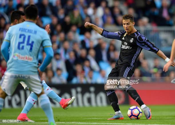 Real Madrid's Portuguese forward Cristiano Ronaldo kicks the ball to score the opener during the Spanish league football match RC Celta de Vigo vs...