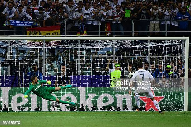 Real Madrid's Portuguese forward Cristiano Ronaldo kicks to score during the penalty shootout in the UEFA Champions League final football match...