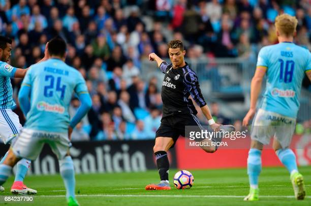 Real Madrid's Portuguese forward Cristiano Ronaldo kicks to score the opener during the Spanish league football match RC Celta de Vigo vs Real Madrid...