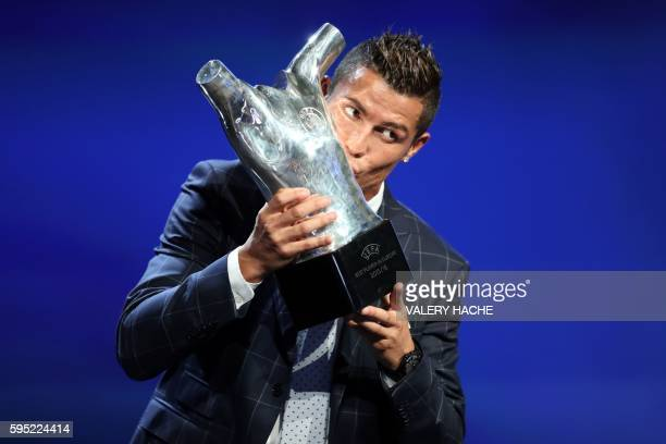 Real Madrid's Portuguese forward Cristiano Ronaldo kisses his trophy of Best Men's player in Europe at the end of the UEFA Champions League Group...
