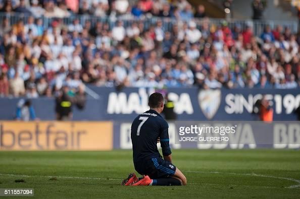 Real Madrid's Portuguese forward Cristiano Ronaldo kneels on the field during the Spanish league football match Malaga CF vs Real Madrid CF at La...