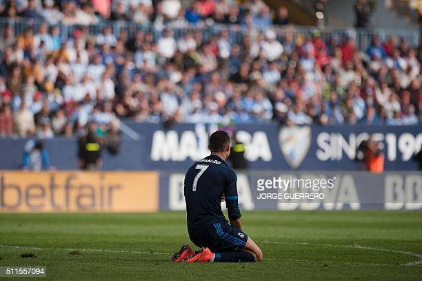 Real Madrid's Portuguese forward Cristiano Ronaldo kneels on the field during the Spanish league football match Malaga CF vs Real Madrid CF at La...