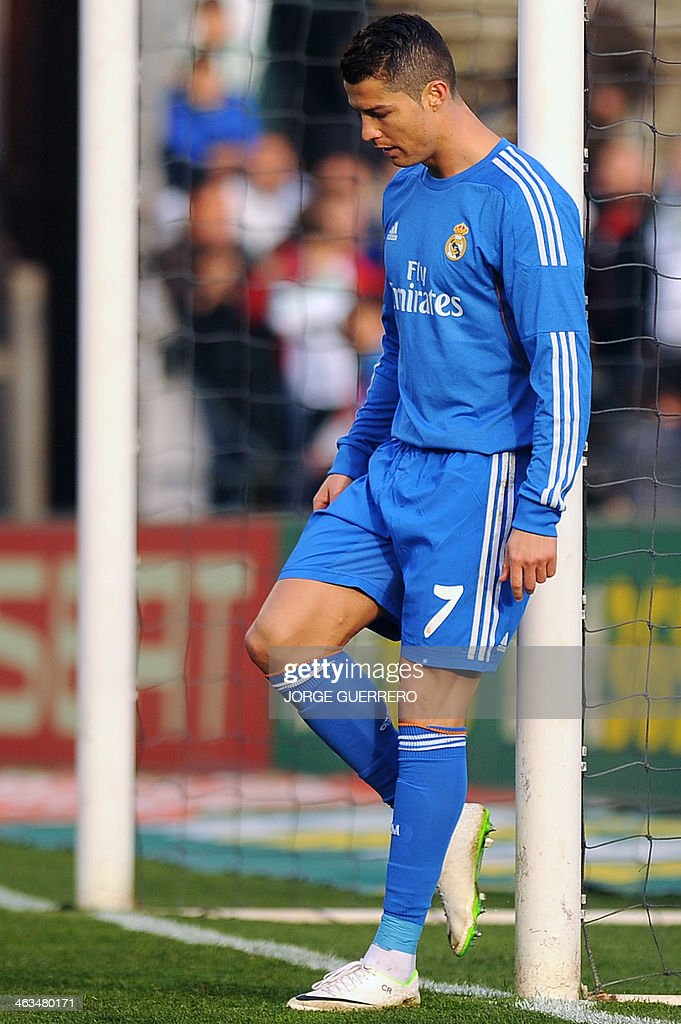 Real Madrid's Portuguese forward Cristiano Ronaldo leans against the goal during the Spanish league football match Real Betis vs Real Madrid on January 18, 2014 at the Benito Villamarin stadium in Sevilla.