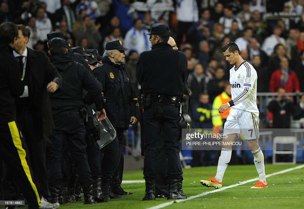 Real Madrid's Portuguese forward Cristiano Ronaldo (R) leaves the field at the end of the UEFA Champions League semi-final second leg football match Real Madrid CF vs Borussia Dortmund at the Santiago Bernabeu stadium in Madrid on April 30, 2013. Borussia Dortmund reached the Champions League final after winning 4-3 on aggregate despite losing 2-0 to Real Madrid in the second leg of their semi-final clash.