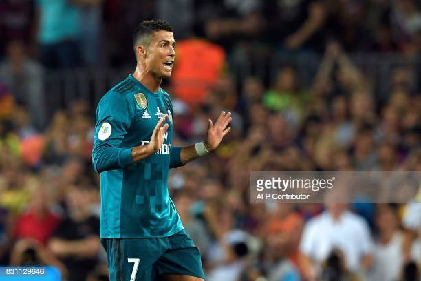 Real Madrid's Portuguese forward Cristiano Ronaldo leaves the field after receiving his second yellow card during the Spanish Supercup first leg...