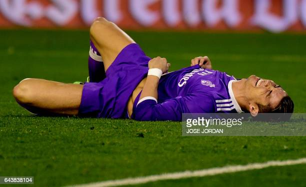 Real Madrid's Portuguese forward Cristiano Ronaldo lies on the field during the Spanish league football match Valencia CF vs Real Madrid CF at the...