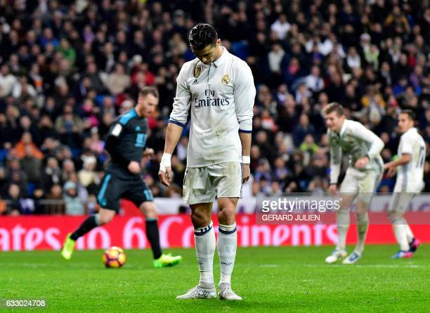 TOPSHOT Real Madrid's Portuguese forward Cristiano Ronaldo looks downwards after missing a goal opportunity during the Spanish league football match...