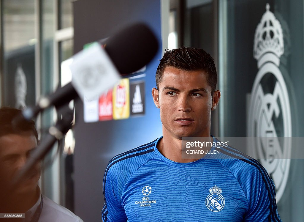 Real Madrid's Portuguese forward Cristiano Ronaldo looks on as he addresses journalists during the club's Open Media Day at Real Madrid sport city in Madrid on May 24, 2016. / AFP / GERARD