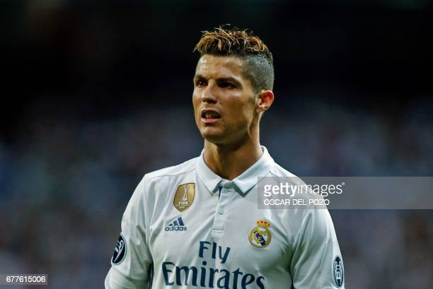 Real Madrid's portuguese forward Cristiano Ronaldo looks on during the UEFA Champions League semifinal first leg football match Real Madrid vs...