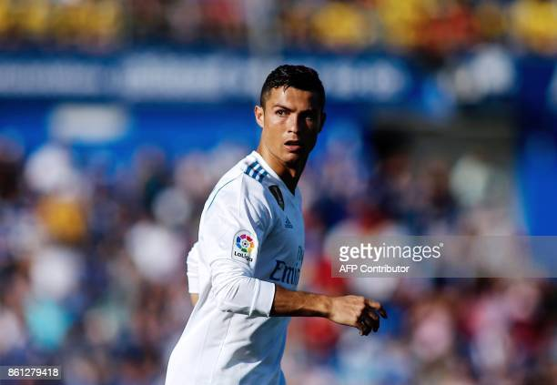 Real Madrid's Portuguese forward Cristiano Ronaldo looks on during the Spanish league football match Getafe CF vs Real Madrid CF at the Col Alfonso...
