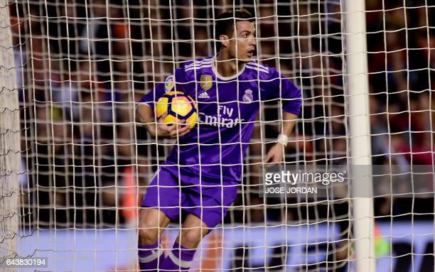 Real Madrid's Portuguese forward Cristiano Ronaldo olds the ball after scoring a goal during the Spanish league football match Valencia CF vs Real...