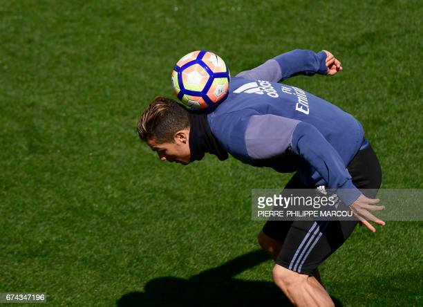 Real Madrid's Portuguese forward Cristiano Ronaldo plays with the ball during a training session at Valdebebas Sport City in Madrid on April 28 2017...